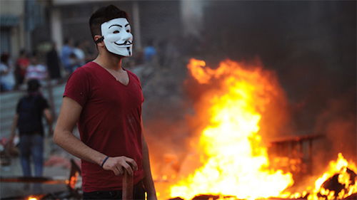 Thomas Frey Futurist Speaker Protester in Turkey wearing a Guy Fawkes mask