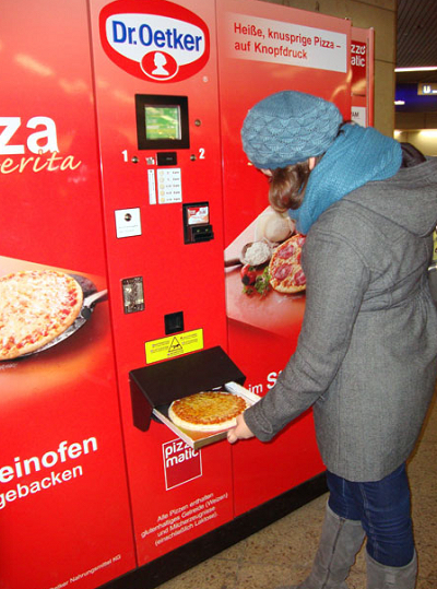 "Thomas Frey Futurist Speaker Pizza vending machine, 9"" pizzas cook in 2 minutes while you wait"