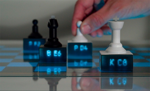 Thomas Frey Futurist Speaker 3D printed chess pieces with light pipes on an interactive tabletop that suggest your next move